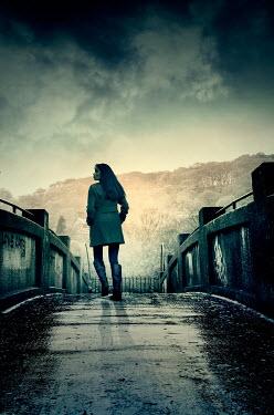 Stephen Mulcahey silhouette of woman crossing country bridge Women