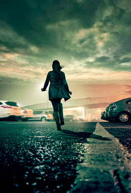 Stephen Mulcahey modern woman running through car park Women