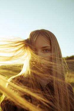 Alina Zhidovinova YOUNG WOMAN WITH BLONDE HAIR IN SUNLIGHT Women