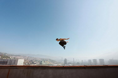 Aida Redzepagic YOUNG MAN JUMPING HIGH ABOVE CITY Men