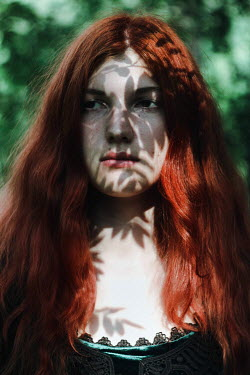 Alina Zhidovinova RED HAIRED WOMAN IN SHADOW OF TREES Women