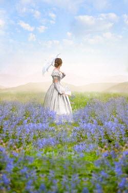 Lee Avison victorian woman in a bluebell meadow Women