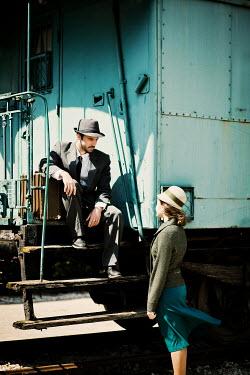 Ildiko Neer Young vintage couple beside train carriage Couples