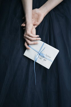 Dorota Gorecka WOMAN IN NAVY DRESS HOLDING LETTER Women