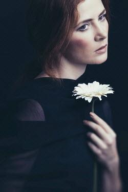 Dorota Gorecka YOUNG BRUNETTE WOMAN HOLDING FLOWER Women