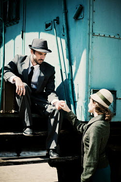 Ildiko Neer Young 1940s couple holding hands beside train Couples