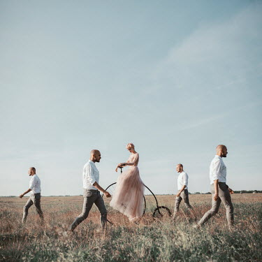 Jovana Rikalo surreal men and woman walking in field Groups/Crowds