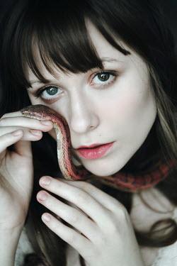 Alina Zhidovinova young brunette woman holding snake Women