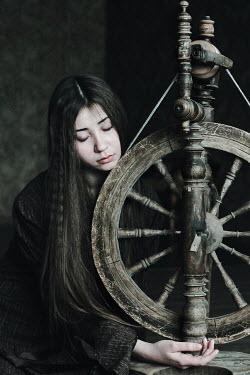 Alina Zhidovinova YOUNG GIRL WITH HISTORICAL SPINNING WHEEL Women