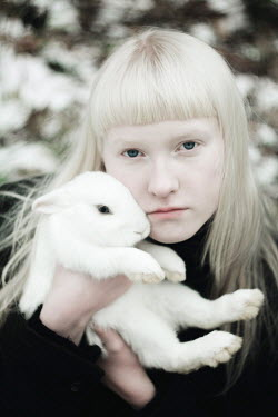 Alina Zhidovinova YOUNG BLONDE WOMAN HOLDING WHITE RABBIT Women