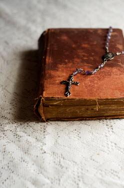 Cristina Mitchell CRUCIFIX PENDANT ON ANTIQUE BIBLE Miscellaneous Objects