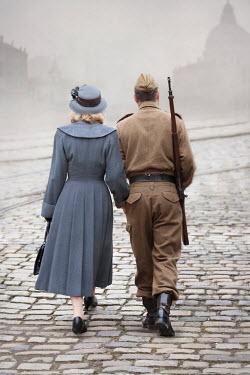 Lee Avison 1940s wartime couple on cobbled street Couples