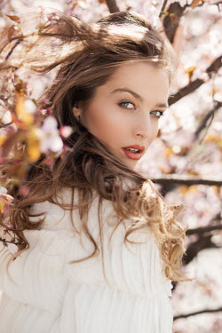 Nina Masic YOUNG BLONDE WOMAN BY BLOSSOM TREE Women