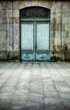 Miguel Sobreira grand door in shabby building Building Detail