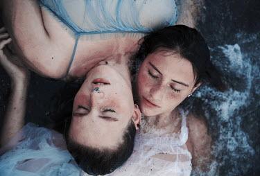 Greta Larosa TWO YOUNG WOMEN LYING IN WATER Groups/Crowds