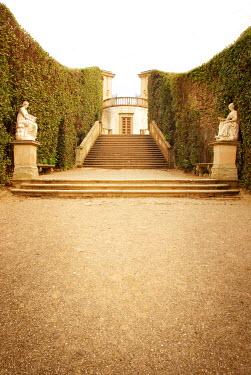 Michael Trevillion statues near steps in grand garden Women