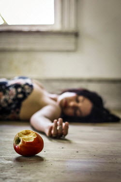 Stephen Carroll YOUNG WOMAN LYING ON FLOOR BESIDE APPLE Women