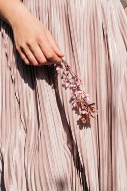 Nina Masic WOMAN IN PINK SKIRT HOLDING FLOWERS Women