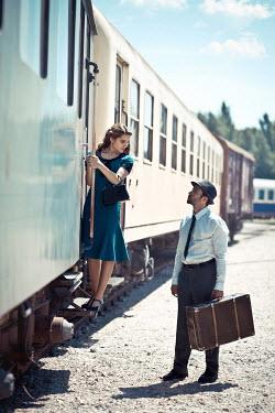 Ildiko Neer 1940'S COUPLE TRAVELLING ON TRAIN Couples