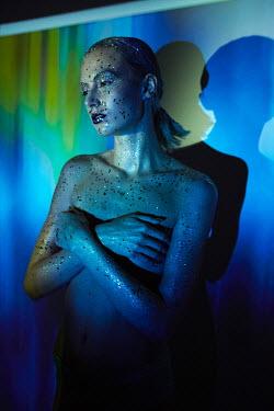 Kate Woodman WOMAN WITH GLITTER IN BLUE LIGHT Women