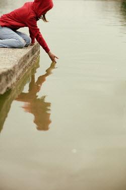 Krasimira Petrova Shishkova MODERN GIRL DIPPING HAND IN CANAL Children