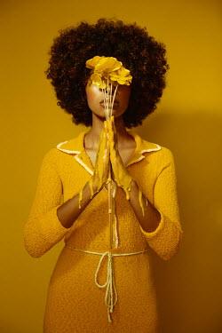 Kate Woodman BLACK WOMAN WITH MELTING YELLOW FLOWERS Women