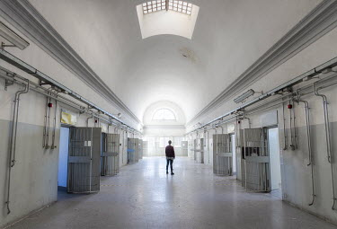 Christophe Dessaigne MAN IN ASYLUM PRISON WITH OPEN DOORS Men