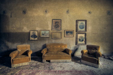 Christophe Dessaigne VINTAGE CHAIRS AND PHOTOS IN DESTROYED ROOM Interiors/Rooms