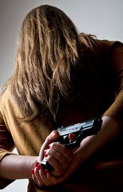 Valentino Sani WOMAN HIDING GUN BEHIND BACK Women