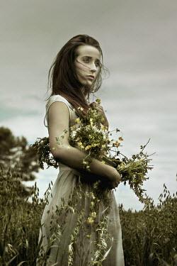 Ashley Lebedev YOUNG BRUNETTE WOMAN GATHERING FLOWERS Women