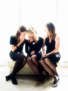 Elisabeth Ansley THREE WOMEN WHISPERING TOGETHER ON SOFA Groups/Crowds