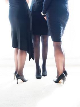Elisabeth Ansley THREE WOMEN WEARING BLACK DRESSES Groups/Crowds