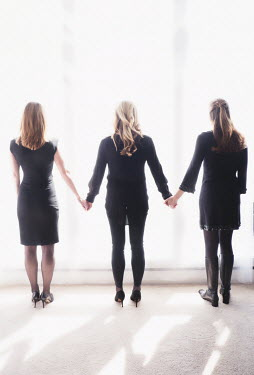 Elisabeth Ansley THREE WOMEN IN BLACK CLOTHING HOLDING HANDS Groups/Crowds