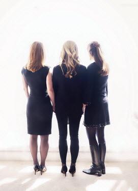 Elisabeth Ansley THREE MODERN WOMEN IN BLACK CLOTHING Groups/Crowds