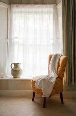 Vesna Armstrong CHAIR AND JUG BESIDE INTERIOR WINDOW Interiors/Rooms