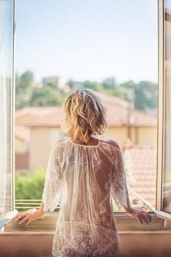 Evelina Kremsdorf BLONDE WOMAN LOOKING OUT WINDOW Women