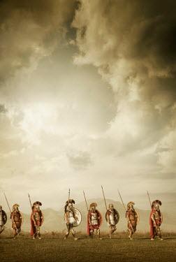 Stephen Mulcahey Ancient Spartan solders marching on battlefield Groups/Crowds