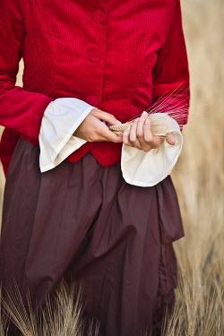 Ildiko Neer Young victorian woman in wheat field Women