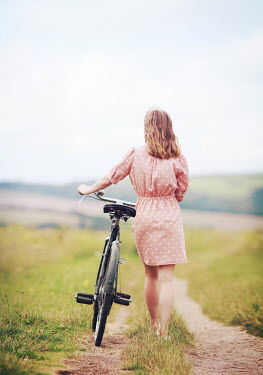 Mark Owen YOUNG WOMAN WITH BICYCLE ON COUNTRY PATH Women
