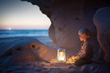 Sveta Butko LITTLE BOY WITH LANTERN IN SANDY CAVE Children