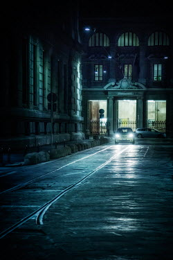 Evelina Kremsdorf CAR SHINING HEADLIGHTS IN CITY AT NIGHT Cars