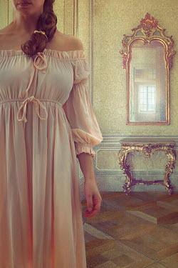 Drunaa vintage Woman beside ornate mirror Women