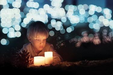 Sveta Butko LITTLE BLOND BOY BESIDE CANDLES AT NIGHT Children