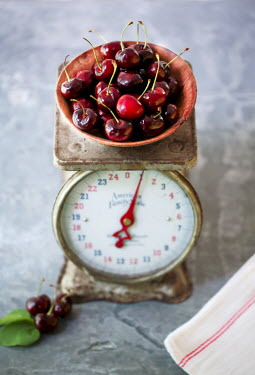 Jean Ladzinski BOWL OF CHERRIES ON WEIGHING SCALES Miscellaneous Objects