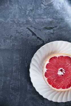 Jean Ladzinski SLICE OF GRAPEFRUIT ON CHINA PLATE Miscellaneous Objects