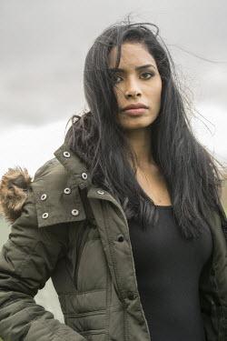 Stephen Mulcahey young indian woman wearing winter jacket Women
