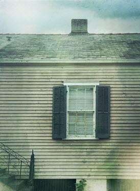 Mark Owen WINDOW WITH SHUTTERS IN WEATHERBOARD HOUSE Houses