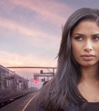 Stephen Mulcahey woman waiting on a train platform Women