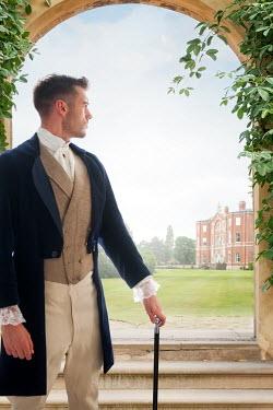 Lee Avison handsome victorian man beside country mansion Men