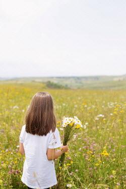 Aida Redzepagic BRUNETTE LITTLE GIRL IN DAISY FIELD Children